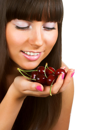 helthcare: beauty woman with  cherries on white