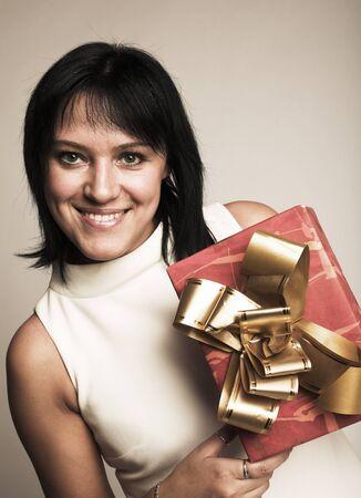 happynes: attractive woman with present, studio shot Stock Photo