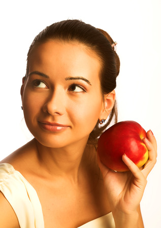 dietetical: Pretty young smiling woman with red apple. over white background