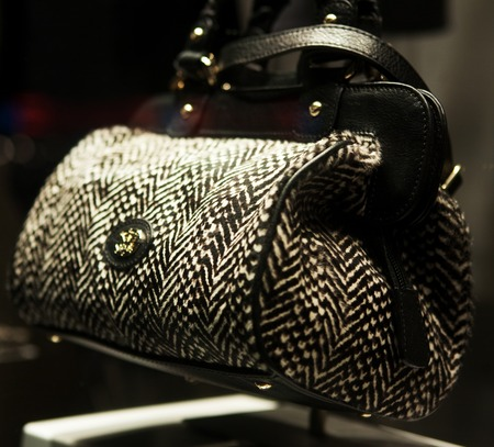 dolly bag: Close-up photo of a handbag exposed in a shop-window Stock Photo
