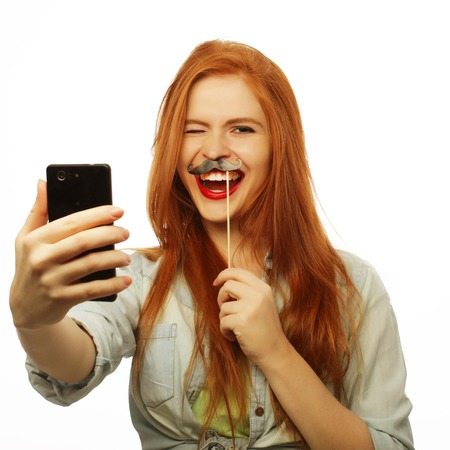 redhair girl ready for party, take selfie 免版税图像