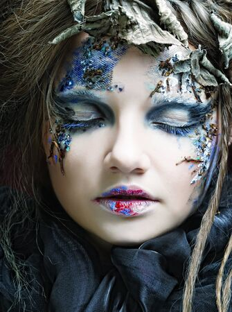Young woman with creative make up. Halloween theme. Stock Photo