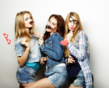 best party: Happy time. Stylish sexy hipster girls best friends ready for party.