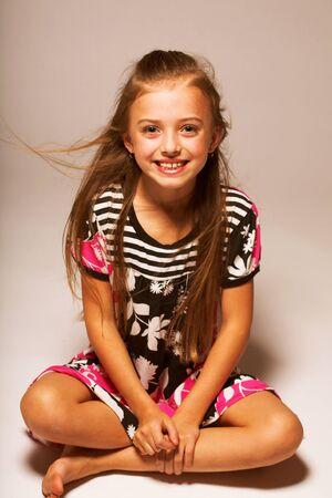 modeling: pretty little girl, studio shot Stock Photo
