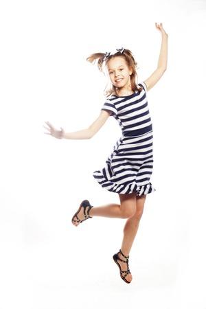 niños actuando: niña salta sobre un fondo blanco Foto de archivo
