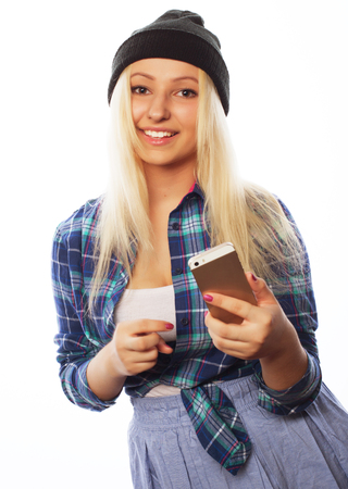 tehnology: People, lifestyle and tehnology concept: pretty teen girl  with smart phone - isolated on white