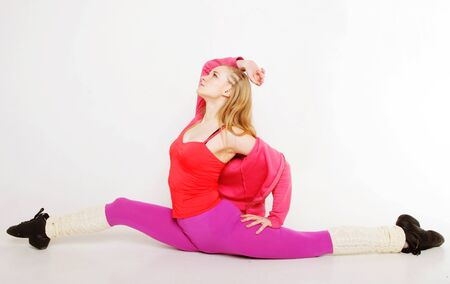 siting: sporty girl  siting on gym split on white background