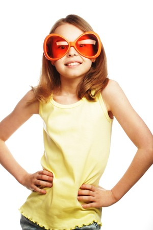 carnaval: happy little girl with fun orange carnaval glasses