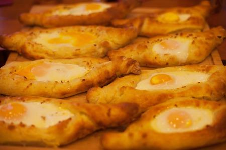georgian: Beautiful open pies khachapuri with egg, Georgian cuisine Stock Photo