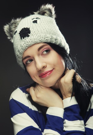 woman wearing hat: Portrait of young funny woman, wearing hat.