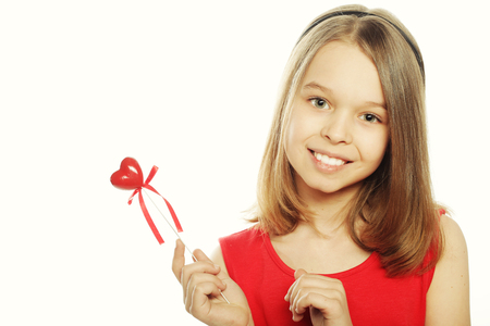 happy little girl in red dress with red heart
