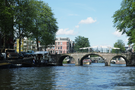 gabled house: Amsterdam canals and typical houses with clear spring sky