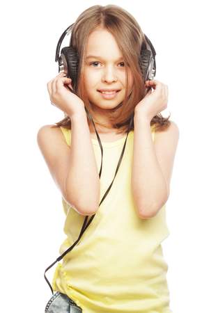 The girl is holding the headphones and smile