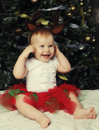 happy christmas: Happy Baby with christmas background Stock Photo