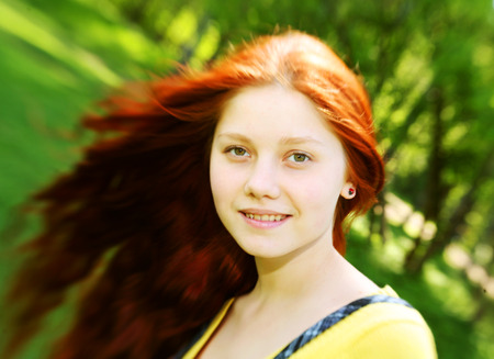 redhaired: Portrait of beautiful smiling redhaired girl, outdoors