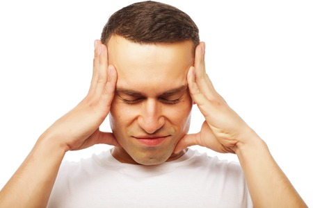 life style and people concept: Attractive young man suffering of strong headache Stock Photo