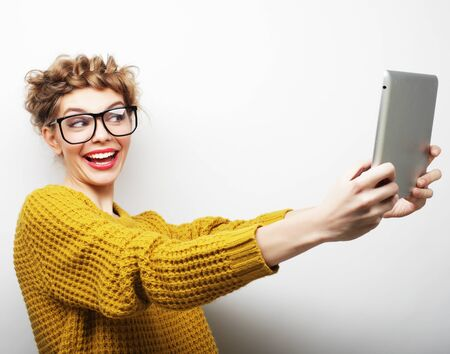 life style, tehnology and people concept: Fhappy teenage girl wearing glasses with tablet pc computer