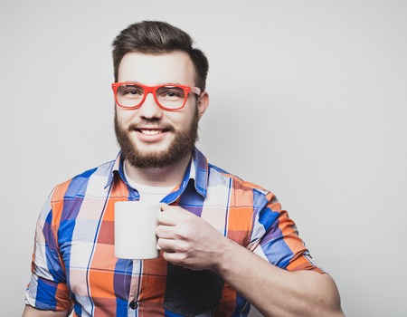 loony: young bearded man with a cup of coffee