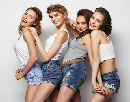 denim jeans: Fashion portrait of four stylish sexy girls best friends