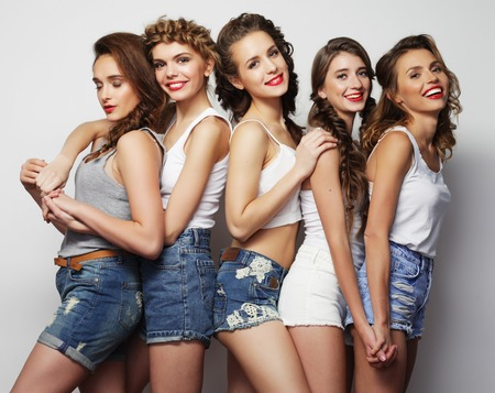 life style and people concept: Fashion portrait of five stylish sexy girls best friends Stock Photo