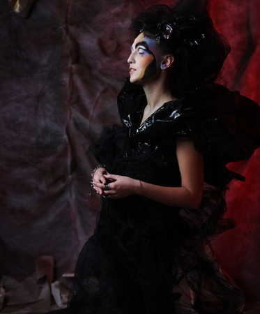 loathsome: Portrait of young stylisn woman with creative visage. Halloween party. Stock Photo