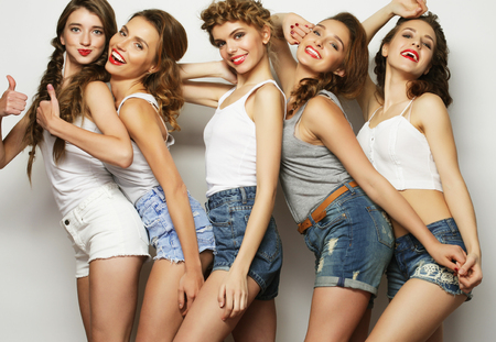 life style and people concept: group of five girls friends photo