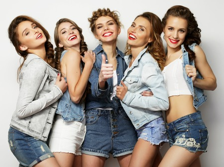 life style and people concept: Fashion portrait of five stylish sexy girls best friends photo