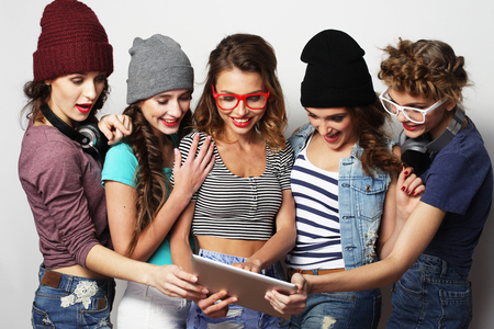life style, tehnology and people concept: five hipster girls friends taking selfie with digital tablet photo
