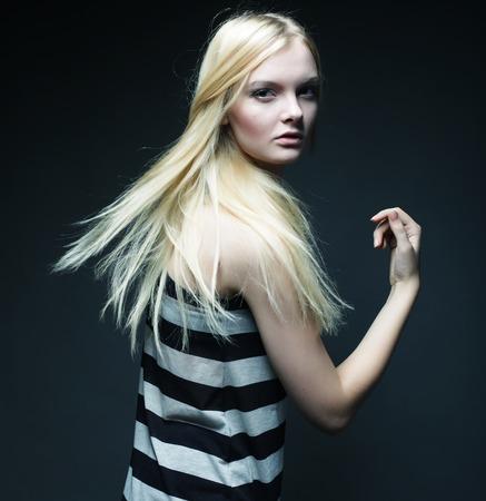 studio shot of pretty fashion model on grey background Stock Photo