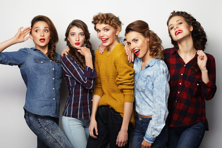 life style and people concept: group of five girls friends, casual style photo
