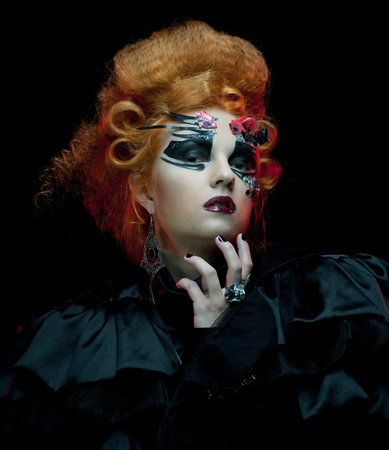 loathsome: Gothic redhair witch. Dark woman. Artistic make up. Halloween picture. Stock Photo