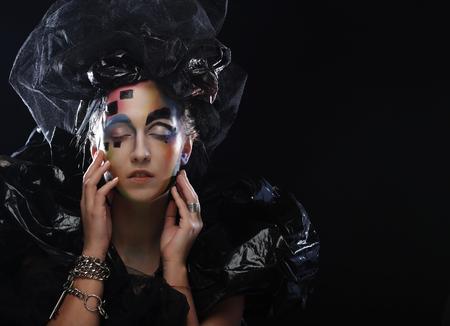 style: Halloween Beauty style woman makeup. Dark style.