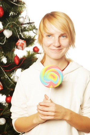 lolipop: woman with lolipop and tree isolated on white Stock Photo