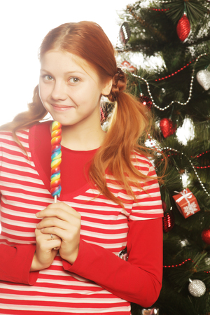 lolipop: redhair woman with lolipop and tree Stock Photo