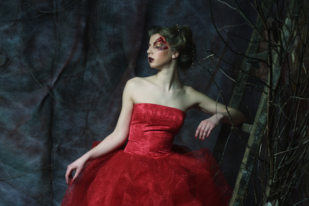 mistery: Fashion portrait of romantic beautiful girl with hairstyle, red lips, art dress.Princess in mistery house. Creative concept Once upon a time in fantasy. Stock Photo
