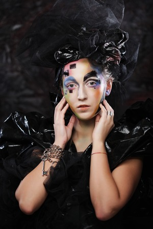 visage: Portrait of young stylisn woman with creative visage. Halloween party. Stock Photo