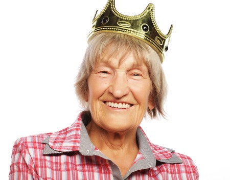 seniority: Senior woman wearing crown doing funky action isolated on white background