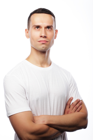 life style and people concept: handsome young man wearing white t-shirt Stock Photo