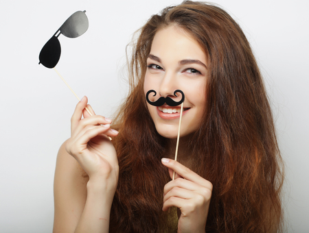 mustaches: Young woman with  fake mustaches. Ready for party.