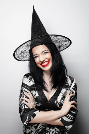 Funny Witch. Young happy woman with canival hat.