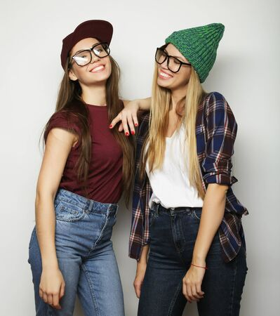 Two young girl friends standing together and having fun Stock Photo