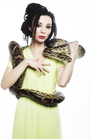 beautiful young woman with a snake Stock Photo