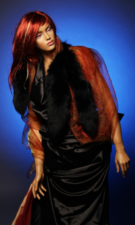 mannequin with red hair, bright studio shot Stock Photo