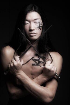 asian boy over black background