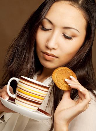 asian woman drinking coffee or tea