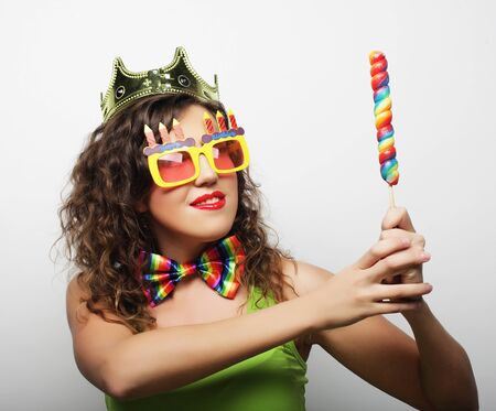 Young woman having fun. Young pretty woman with crown is laughin