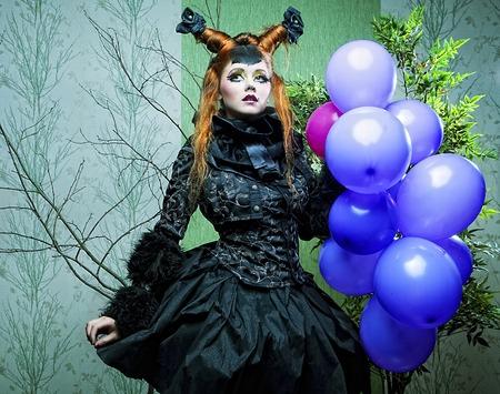 Princess with balloons.