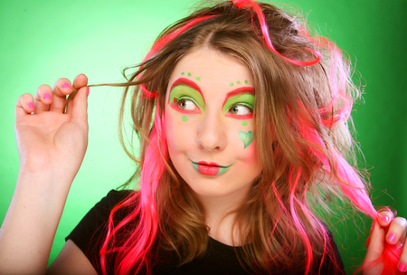 rudeness: funny girl over green background