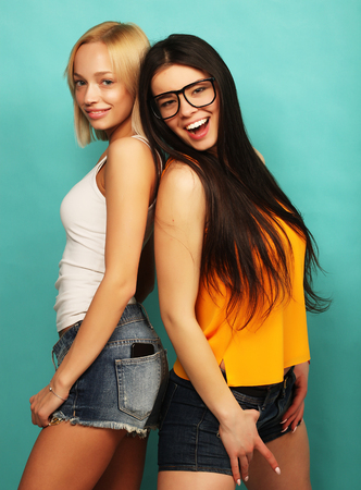 bl: Two young girl friends standing together and having fun. Over bl Stock Photo