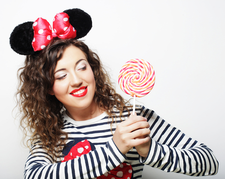 mouse: young woman with mouse ears over white background